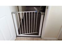 2 Lindam safety gates with extensions and a travel gate