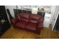 Two red leather sofas for sale, three seater and two seater. incredibly comfy. Pick up only.