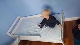 Nearly new toddler bed with mattress
