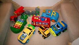 Bundle of toys, train and ride on car