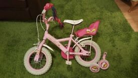 Great condition, with stabilisers and back seat for a toy and fancy handlebar ribbons.