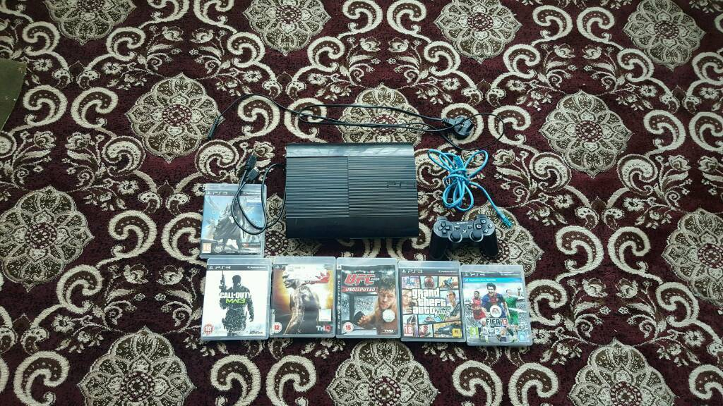 PS3 SUPER SLIM VERY CHEAP MINT CONDITION AND LOADS OF GAMES!