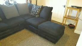 black and grey corner sofa and foot stool