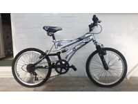 Octane Special Edition Unisex Mountain Bike for Ages 8-11 in silver & black. Excellent - Hardly used