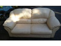 Free 2 Seater Cream Leather Sofa in good condition