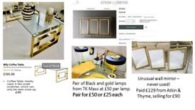 Gold & Glass coffee table. Gold Mirror. Black and gold table lamps