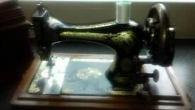 Antique Singer sewing machine in box