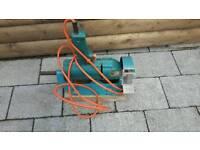 Bench grinder drill attachment