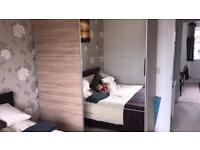 Mirrored wooden effect large double sliding wardrobe