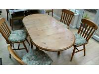 Drop leaf extendable kitchen table and four chairs. Good condition. Removable legs for storage.