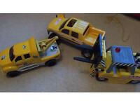 3 large Tonka trucks