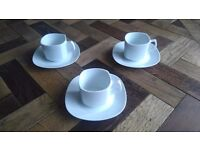 3 coffee cups and saucers
