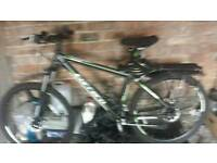 Mountain Bike Carrera 24 Speed, Twin Hydraulic Brakes with Security Locks ,Helmet 54-61cm, Pump etc.