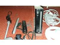 Black wii console and games