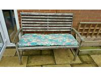 Garden bench with seat cushion