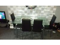 Chrome extending dining table and chairs