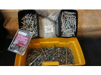 Toolbox full of various screws, fixings and bolts