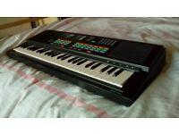 Yamaha PSS-470 | 49-Key Vintage Electronic Keyboard/Synthesizer + Carry Bag