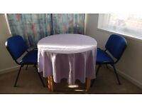 Round table and two chairs for sale