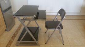 Desk with folding chair. Black glass effect. Retractable keyboard shelf.