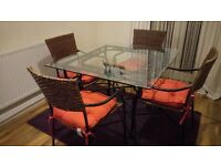 Heavy glass top, iron table and 4 wicker chairs