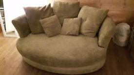 2 seater green cuddle sofa