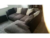 Grey corner sofa good condition has blaxk faux base and back