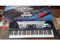 YAMAHA ELECTRONIC KEYBOARD EZ150 & Stand -NEW NEVER USED. IN BOX WITH STAND