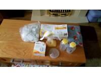 Medela Harmony manual breast pump with extras