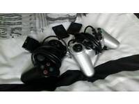 2 Playstatio 2 Controllers & 2 memory cards