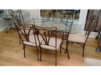 Glass table and 6 metal chairs
