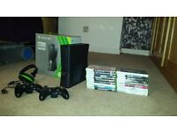 XBox 360, 250GB with 2 controllers, headset and 18 quality games.