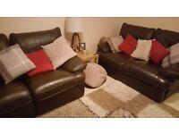 ** 2x dark brown leather recliner sofas **