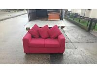Very nice 2 seater sofa in red material £85