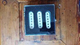 Set of 3 white Fender 1950's 'classic' Strat Mexican re-issue pickups, 1 year old, mint condition.