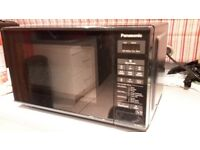 Panasonic 800w microwave in black.