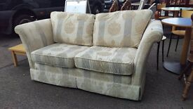 Cream patterned 2 seater winged fabric sofa