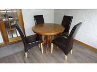 ROUND CHERRY EXTENDING DINING ROOM TABLE