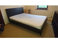Black faux leather double bed, good condition