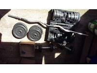 two sets of dumbells and ez curl bar with weights ,not used any more