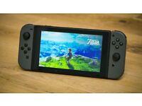 Nintendo Switch grey + Zelda Breath of the wild + Mario Kart 8 + official case