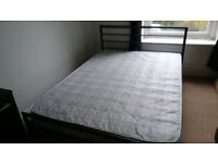 double bed brand new with matress metal framed