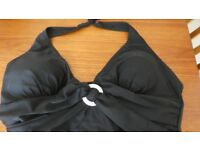 Black swimsuit. with a white buckle size XL (16)