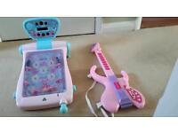 Childs Pinball machine and guitar