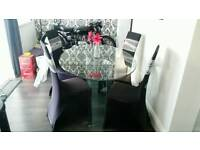 Solid glass oval table and 6 faux leather brown chairs