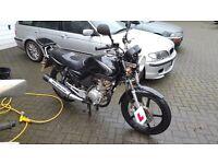 Yamaha YBR125 with rear rack in very nice condition.