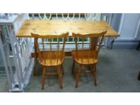 WOODEN TABLE AND 2 WOODEN CHAIRS USED