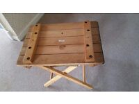 Lovely wood side table - thick vintage wood drawing board on folding legs.
