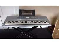 76 key Yamaha DGX-200 Electric Keyboard including music stand and Duronic keyboard stand