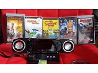 PSP consoles with games and speaker dock